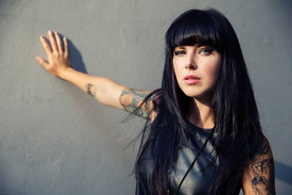 Alexis Krauss Confidently Plays With Guns