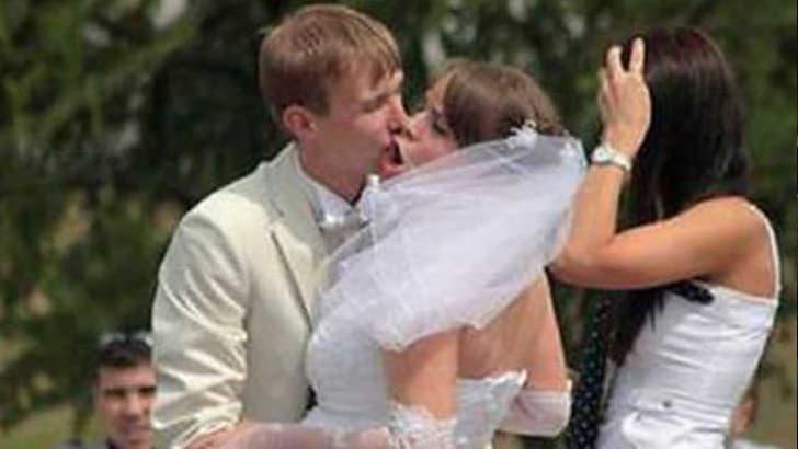 Awkward Wedding Kiss