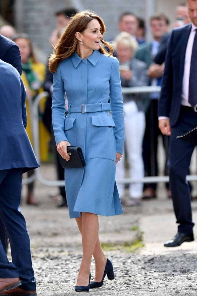 Wearing Her Signature Coat